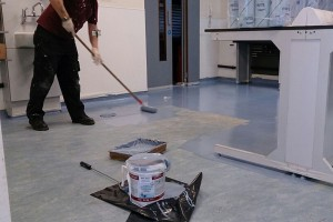 man re-colouring / painting a floor - before